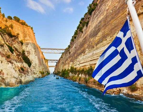 Corinth channel in Greece and greek flag on ship - travel background-shutterstock_79919644.jpg